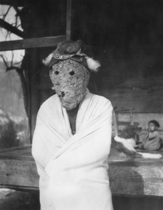 Booger Dancer in mask made of a wasps' nest. 1936.